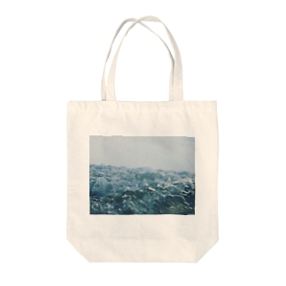 Water is the root of everything Tote bags
