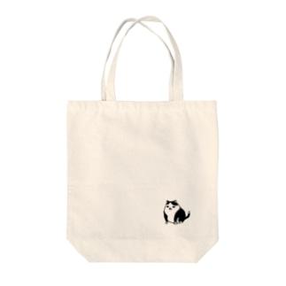 例の猫 Tote bags