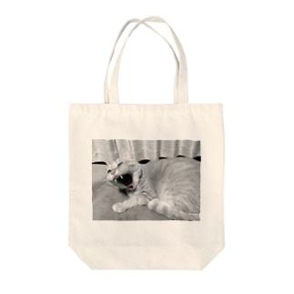 あくび。 Tote bags