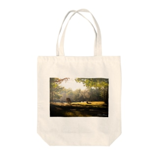 Deers in the Light Tote bags