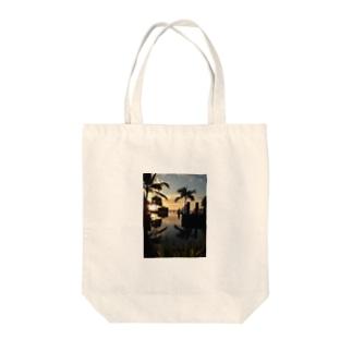 楽園 Tote bags