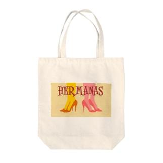 HERMANAS Tote bags