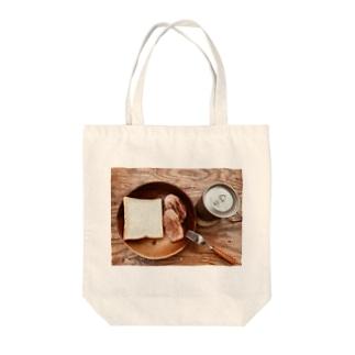 食パン Tote bags