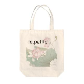 m.petite item Tote bags