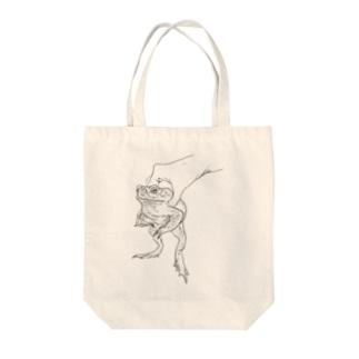 a kaeru in the hand オオヒキガエル Tote bags