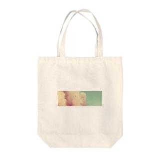 質素に Tote bags