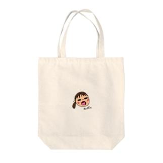 変な顔の娘 Tote bags