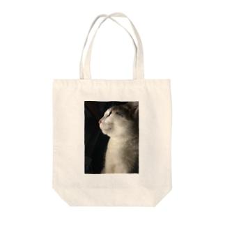 君の横顔 Tote bags