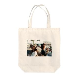 館山の駅のホーム Tote bags