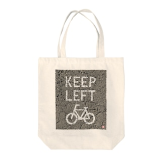 KEEP LEFT Tote bags
