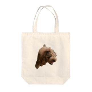 顔が変なフー Tote bags