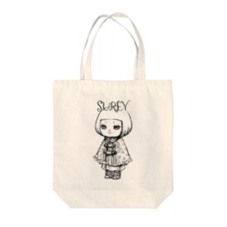 ポンチョを着た女の子 Tote bags