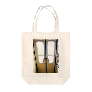 扉っ Tote bags