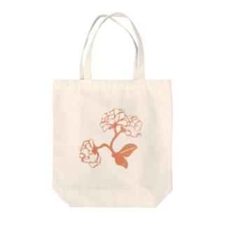 花開く Tote bags