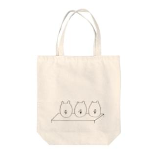 評価されるくま Tote bags