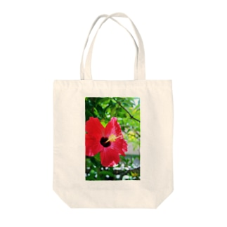 a hibiscus Tote bags