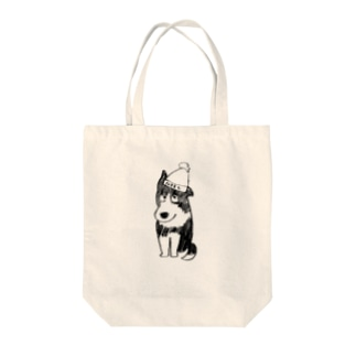 何か言いたげな犬 Tote bags