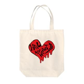 HEAL MY HEART Tote bags