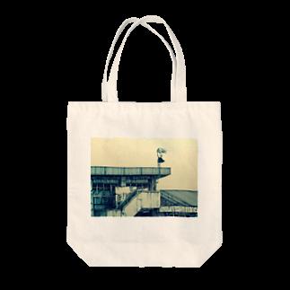 どせいのわっかの風強い Tote bags