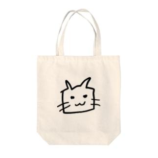 にやけるネコ Tote bags
