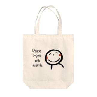 微笑み Tote bags