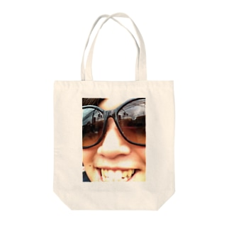 Smile gets luck. Tote bags