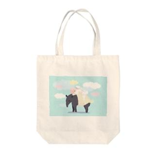 バクと少女 Tote bags