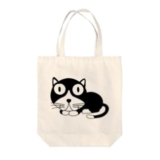 ギョロ目クロネコ Tote bags