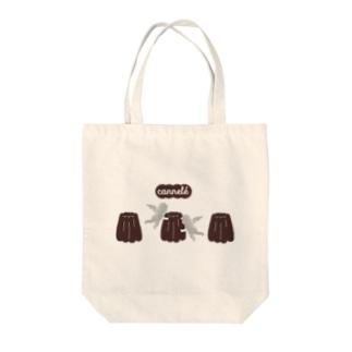 カヌレ Tote bags