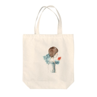 横顔 Tote bags