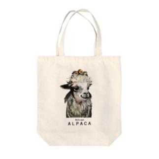 ふわふわヘアーを小鳥の巣にされてもうれしそうなアルパカさん Tote bags