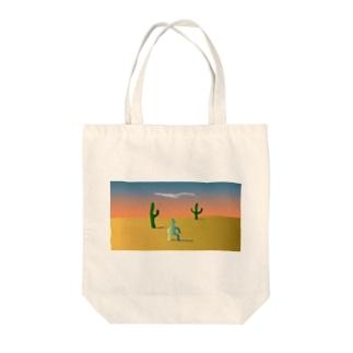 砂漠に1人佇む Tote bags