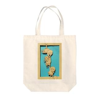 ぎゅっ Tote bags