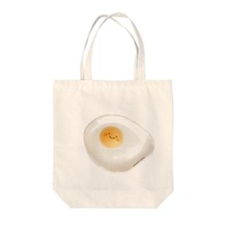 スマイル目玉焼き Tote bags