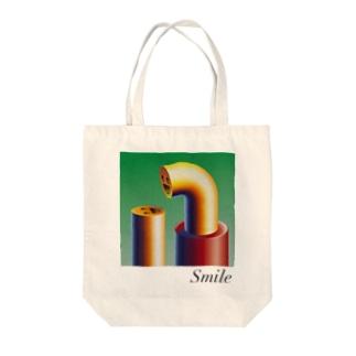 スマイル Tote bags