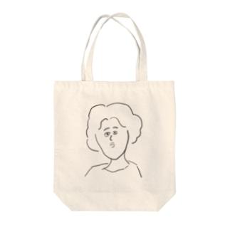 こっち見てる Tote bags