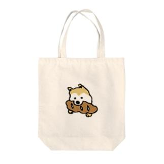 パンをくわえた犬① Tote bags