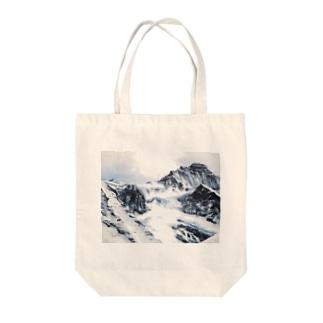 ユングフラウ Tote bags