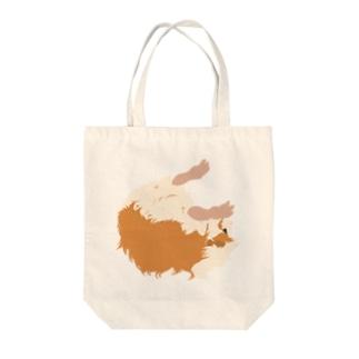 空中と水中を漂うモルモット Tote bags