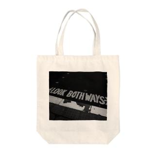 LOOK BOTHWAYS Tote bags