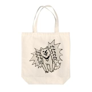 笑っている犬 Tote bags