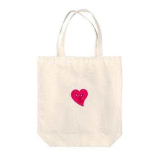 ピンクのハート Tote bags