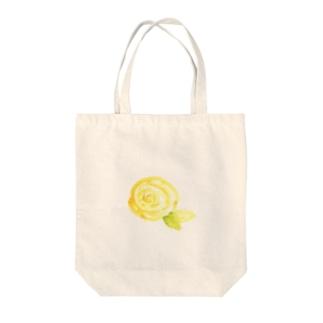 黄色のバラ Tote bags