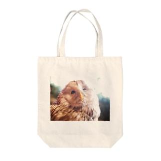 ヤバイふくろう屋さんのあざ笑うフクロウ Tote bags