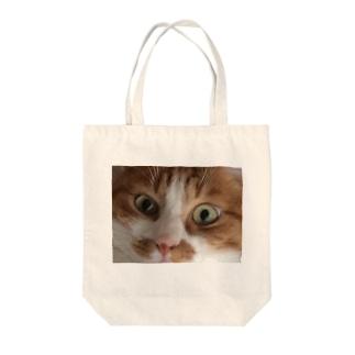 ねこのめ Tote bags