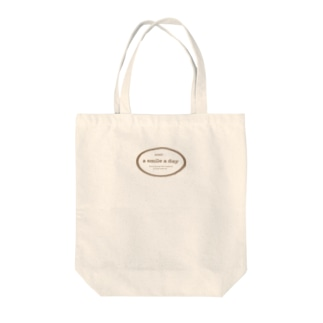 a smile a day Tote bags