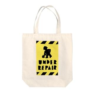 UNDER REPAIR Tote bags