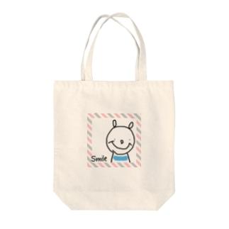 スマイル熊さん Tote bags