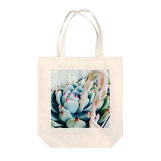 モモスケ Tote bags