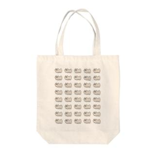 にゅ Tote bags